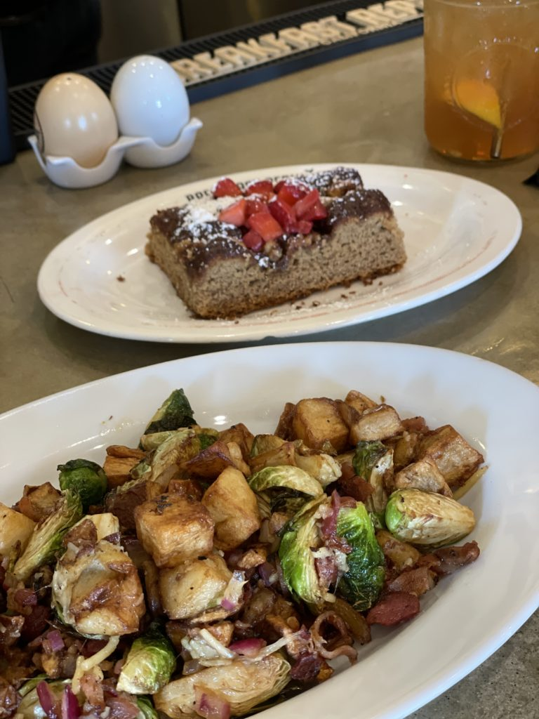 brussel sprouts with potatoes at the bar at Breakfast Republic in Liberty Station in San Diego, California