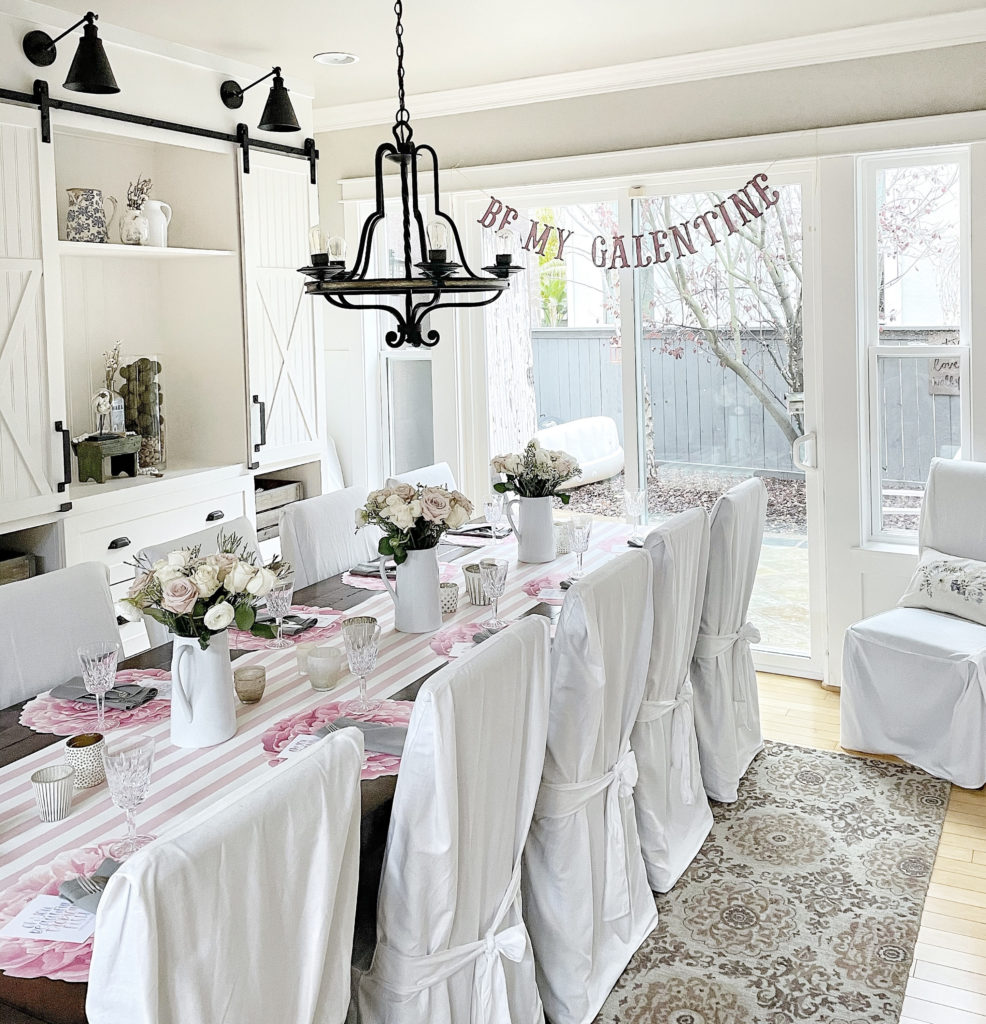 start a book club galentines day dining room table tablescape with blush roses and board and batten and sherwin williams accessible beige