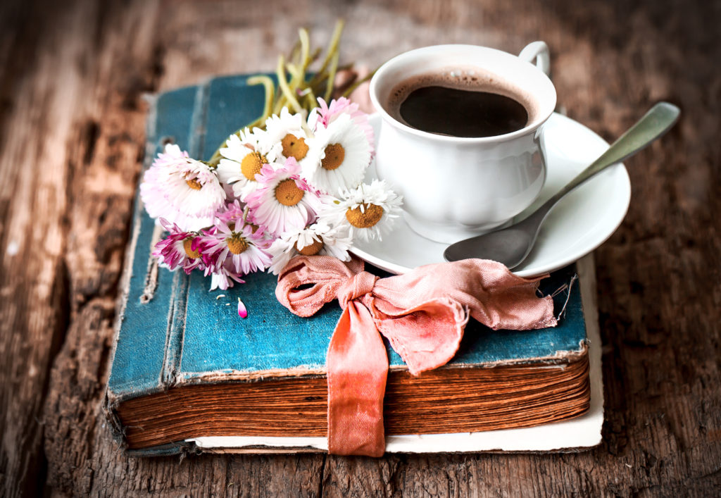 how to start a book club blue book with coffee cup and white daisies