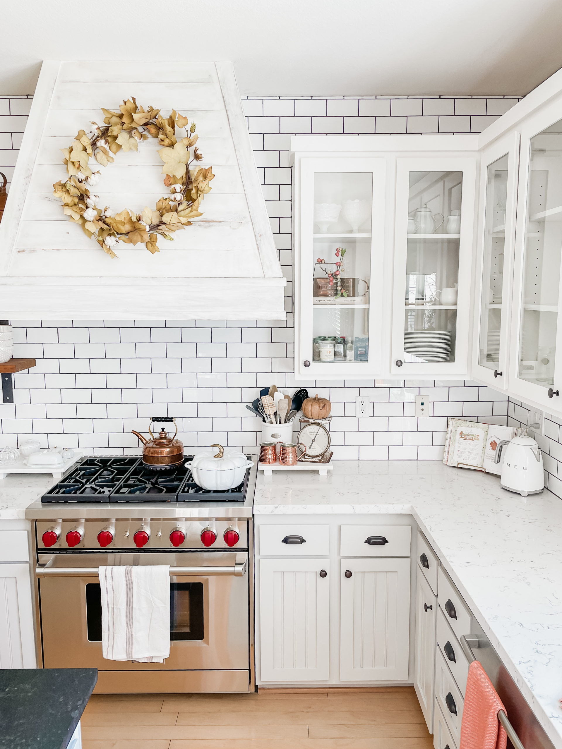 How to add simple fall decor to the kitchen. Includes neutral fall decor ideas. Walls are painted Sherwin Williams accessible beige. Photos have quartz countertops and and soapstone countertops with white subway tile backsplash. .