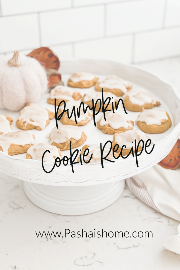 Pumpkin Cookie recipe that will surely be a fall favorite as they are a pumpkin cookie on a pretty white cake stand.  Wall color is Sherwin Williams Accessible Beige.  Perimeter countertops are white quartz and island is soapstone.  Backsplash is white subway tile with gray grout.